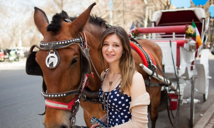 Alexandra Summa poses with 13-year-old carriage horse Rosie on Central Park South, Manhattan, April 12, 2014. (Petr Svab/Epoch Times)