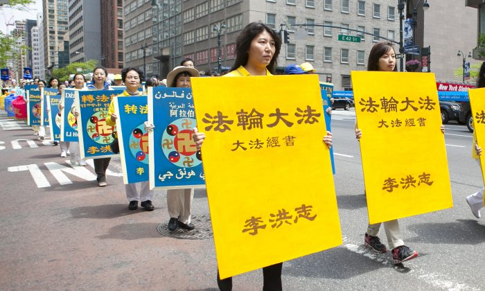 Shiping Lu at a Falun Dafa parade in Manhattan, May 14, 2014. She has been practicing Falun Dafa since 1995 and was detained by the Chinese regime five times for her belief. (Samira Bouaou/Epoch Times)