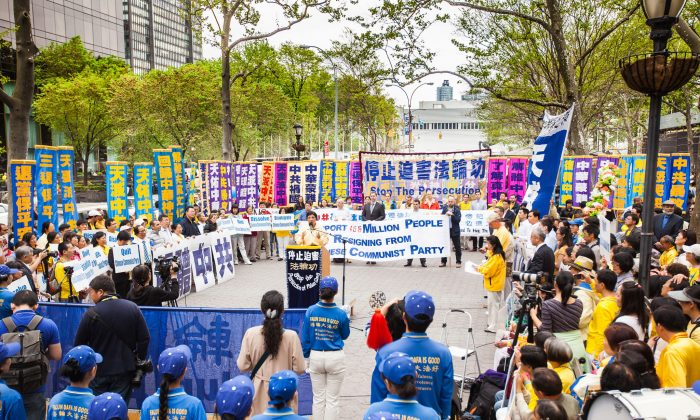 Practitioners of Falun Dafa (also called Falun Gong) participate in a rally on Dag Hammarskjold Plaza beside the United Nations headquarters in Manhattan, New York, on May 14, 2014. Over 8,000 practitioners of Falun Dafa gathered in New York to celebrate May 13 World Falun Dafa Day and raise awareness about the persecution of their fellow practitioners under the Communist Party's regime in China. (Petr Svab/Epoch Times)