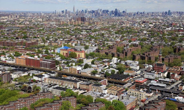 The Brooklyn borough of New York is shown in this April 20, 2010, aerial photo. The Manhattan skyline is in the distance. Mayor Bill de Blasio has an ambitious plan is to build or preserve 200,000 affordable units of housing over the next 10 years for lower-income New Yorkers, a staggering number that would house a population bigger than cities such as Atlanta or Minneapolis. (AP Photo/Mark Lennihan)