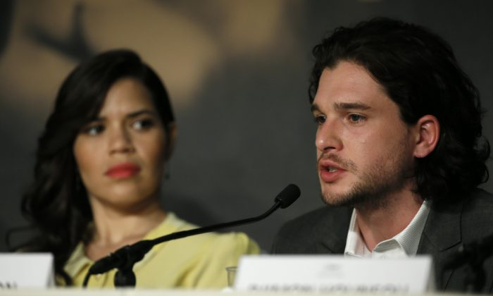 Actor Kit Harington, right, speaks during a press conference for How to Train Your Dragon 2 alongside actress America Ferrera at the 67th international film festival, Cannes, southern France, Friday, May 16, 2014. (AP Photo/Alastair Grant)