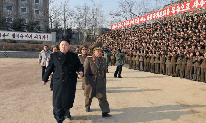 This undated picture released from North Korea's official Korean Central News Agency (KCNA) on January 12, 2014 shows North Korean leader Kim Jong-Un (front L) inspecting the command of Korean People's Army (KPA) Unit 534. (KNS/AFP/Getty Images)