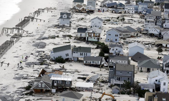 This Oct. 31, 2012, aerial photo shows destruction in the wake of Superstorm Sandy in Seaside Heights, N.J. (AP Photo/Mike Groll)