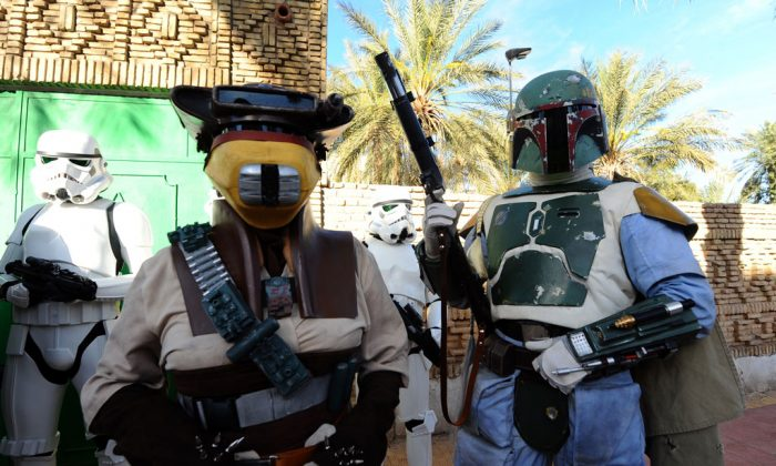 Fans of the movie franchise Star Wars wearing costumes of the movie's characters, Boba Fett (R) and Stormtrooper (L) pose on May 3, 2014 during a parade as part of the first international meeting of the fans of the movie in Tozeur, in southern Tunisia. (Fethi Belaid/AFP/Getty Images)