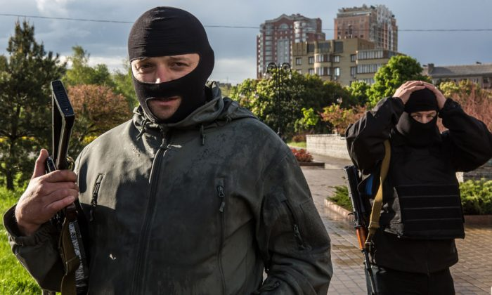 Pro-Russian activists pose for a picture outside the occupied regional administration building, which serves as their local headquarters, on May 8, 2014 in Donetsk, Ukraine. Tensions in Eastern Ukraine are high after pro-Russian activists seized control of at least ten cities ahead of the Victory Day holiday and a planned referendum on greater autonomy for the region. (Brendan Hoffman/Getty Images)