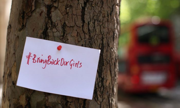 A sign that reads 'Bring back our girls' is pinned to a tree as protesters calling for the release of a group of abducted Nigerian schoolgirls gather outside Nigeria House on May 9, 2014 in London, England. 276 schoolgirls were abducted from their boarding school on 14 April, 2014 in the town of Chibok in north-eastern Borno state in Nigeria. The abductions have sparked protests around the world calling for the release of the girls who are being held by the militant group Boko Haram. (Dan Kitwood/Getty Images)