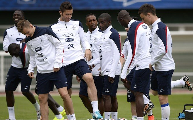 France's forward Antoine Griezmann, forward Olivier Giroud, defender Patrice Evra, midfielder Rio Mavuba, forward Mathieu Valbuena, and defender Laurent Koscielny (R) take part in a training session in Clairefontaine-en-Yvelines, outside Paris, on May 29, 2014, during the team's preparation for the upcoming FIFA 2014 World Cup. (FRANCK FIFE/AFP/Getty Images)