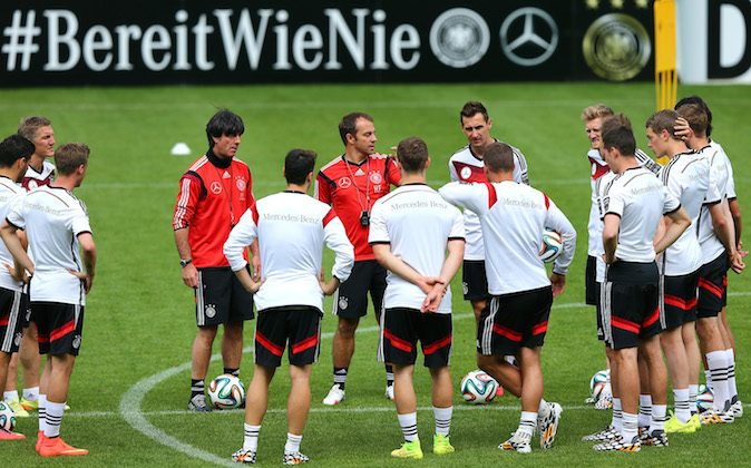 Head caoch Joachim Loew (L) gives instructiona to the team during the German National team training session at St.Martin training ground on May 30, 2014 in St. Martin in Passeier, Italy. (Photo by Martin Rose/Bongarts/Getty Images)