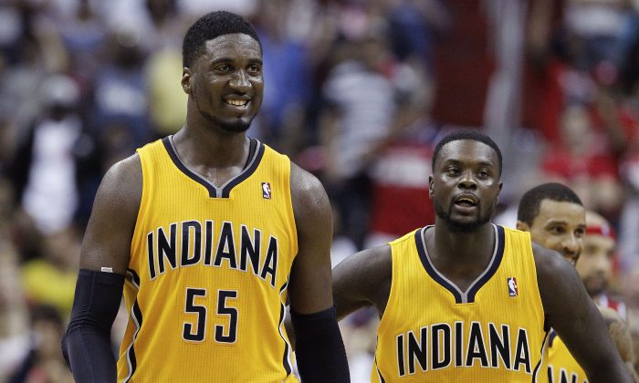 Indiana Pacers center Roy Hibbert (55) smiles as he walks across the court with Indiana Pacers guard Lance Stephenson (1) in the closing minutes of the second half of Game 4 of an Eastern Conference semifinal NBA basketball playoff game in Washington, Sunday, May 11, 2014. The Pacers won 95-92. (AP Photo/Alex Brandon)