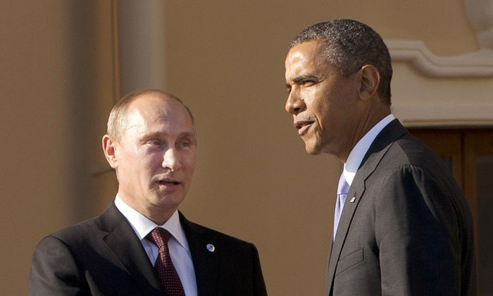 In this Sept. 5, 2013, photo President Barack Obama shakes hands with Russian President Vladimir Putin during arrivals for the G-20 summit at the Konstantin Palace in St. Petersburg, Russia, Thursday, Sept. 5, 2013. (AP Photo/Pablo Martinez Monsivais)