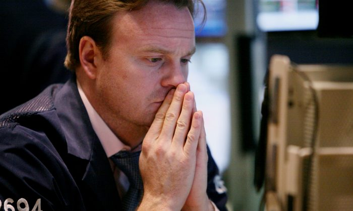 A trader looks at price charts on the floor of the New York Stock Exchange in this file photo. Recent market action and fundamentals are starting to worry investors. (AP Photos/Bebeto Matthews)  (AP Photos/Bebeto Matthews)