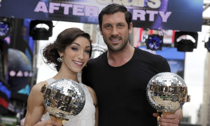 "Olympic athlete Meryl Davis and dancer Maksim Chmerkovskiy, winners of ""Dancing with the Stars"" , appear on ABC's Good Morning America on Wednesday, May 21, 2014, in New York. (Andy Kropa/Invision/AP)"