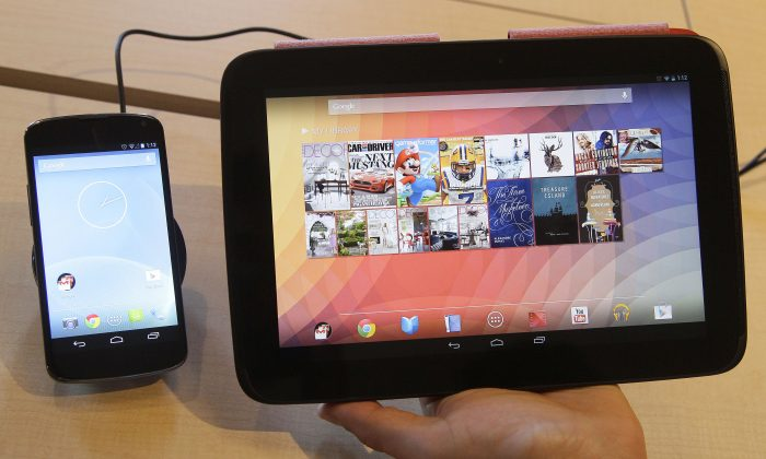 The Nexus 4 smartphone, left and the Nexus 10 tablet in a file photo. The upcoming Android KitKat 4.4.3 update did not happen on May 22, 2014 as rumored. (AP Photo/Jeff Chiu)