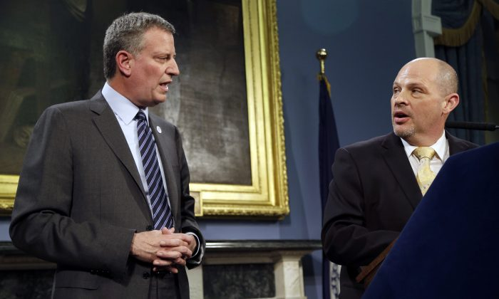 President of the United Federation of Teachers Michael Mulgrew (R) and Mayor Bill de Blasio announce a contract deal at City Hall in Manhattan on May 1. (Seth Wenig/AP)