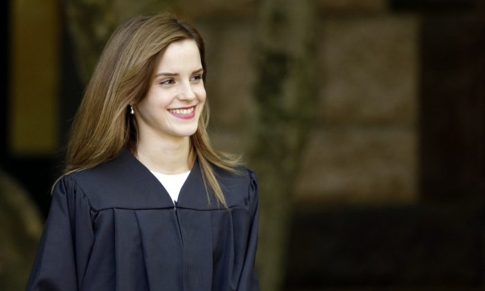 Actress Emma Watson walks between buildings following commencement services on the campus of Brown University, Sunday, May 25, 2014, in Providence, R.I. (AP Photo/Steven Senne)