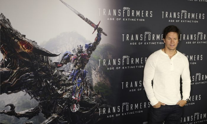 Actor Mark Wahlberg poses for a photo on the red carpet premier of his new movie Transformers; Age of Extinction in Sydney Australia Wednesday, May 21, 2014, (AP Photo/Rob Griffith)