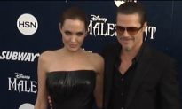 Brad Pitt Punched in Face on Red Carpet (Video)