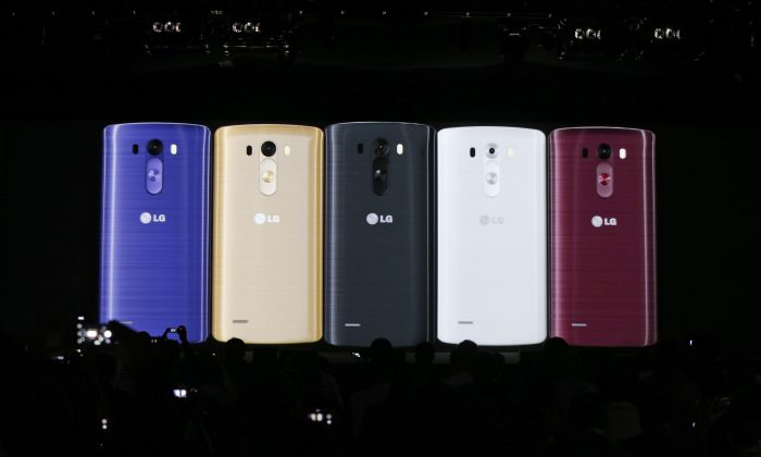 Images of the newly-unveiled LG smartphone, called the G3, are presented at a press event in London, Tuesday, May 27, 2014. (AP Photo/Lefteris Pitarakis)