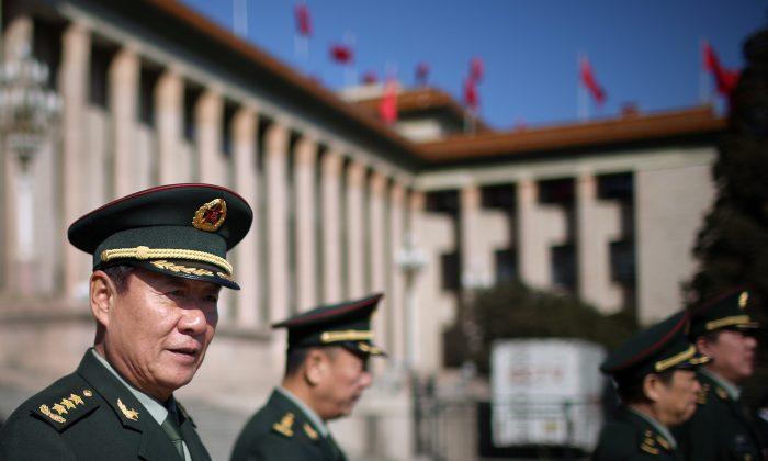 General Liu Yuan (Left), political commissar of the General Logistics Department of China's military, leaves the Great Hall of the People on March 4 in Beijing. The Chinese regime employs many tools of deception to advance its military goals. (Feng Li/Getty Images)