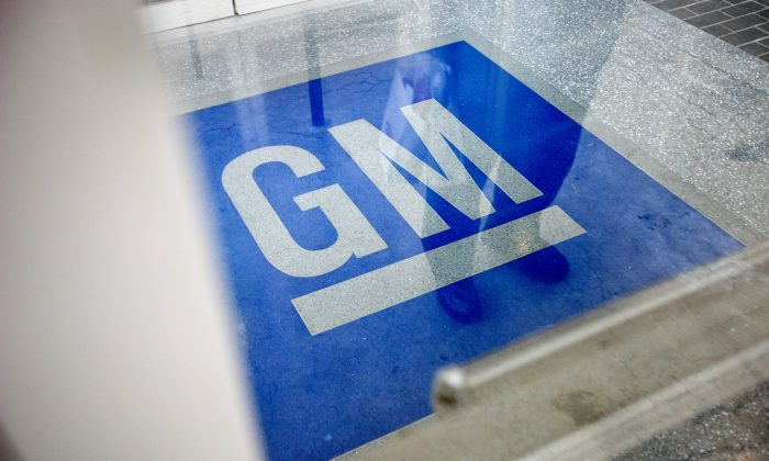 The General Motors' logo decorates the entrance at the site of a GM information technology center in Roswell, Ga., on Jan. 10, 2013. (AP Photo/David Goldman)