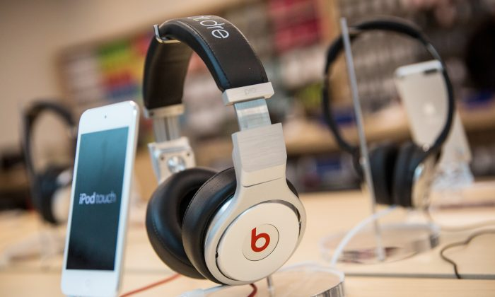 Beats headphones next to an iPod Touch in an Apple store on May 9, 2014 in New York City.   (Andrew Burton/Getty Images)