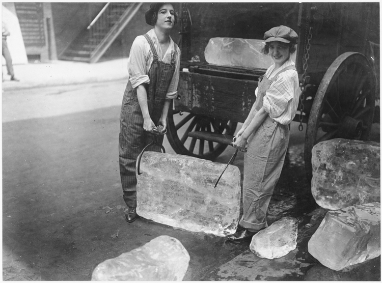 Girls help deliver ice on Sept. 16, 1918—work usually done by men—to help out during WWI.