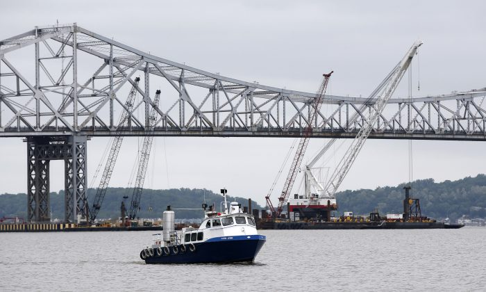 A boat makes it's way up the Hudson River north of the Tappan Zee Bridge, under construction in Tarrytown, N.Y., Wednesday, May 28, 2014. (AP Photo/Kathy Willens)