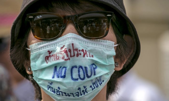 A Thai protester wears a face mask against the military coup during anti-coup protests in Bangkok, Thailand, on May 28, 2014. (Paula Bronstein/Getty Images)