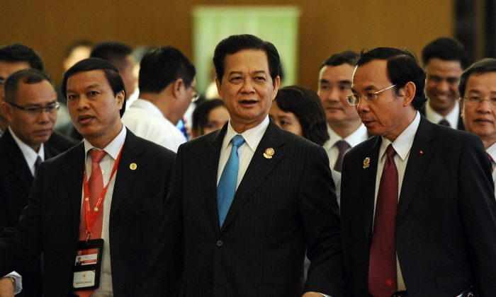 Vietnam's Prime Minister Nguyen Tan Dung (C) walks along with members of his delegation during the ASEAN summit at the Myanmar International Convention Center in Naypyidaw on May 11. On Sunday he criticized China's aggression in the South China Sea. (CHRISTOPHE ARCHAMBAULT/AFP/Getty Images)