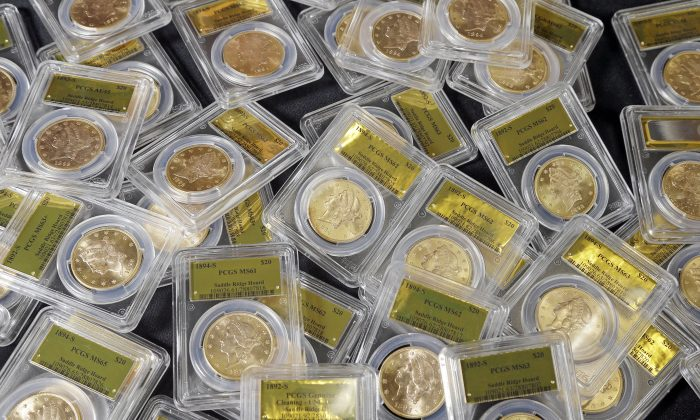 This photo shows some of the 1,427 Gold-Rush era U.S. gold coins displayed at Professional Coin Grading Service in Santa Ana, Calif.. on Feb.  24, 2015. (Reed Saxon/AP Photo)