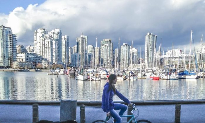 A cyclist takes her dog for a run along Vancouver's seawall. With the kickoff of Bike to Work Week on May 26, Bike Day goes nationwide in an effort to advance Canada's bike culture. (Courtesy Vancouver Cycle Chic)
