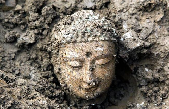 One of the 3,000 Buddha statues uncovered in 2012. (Sun Zifa/ImagineChina/AP)