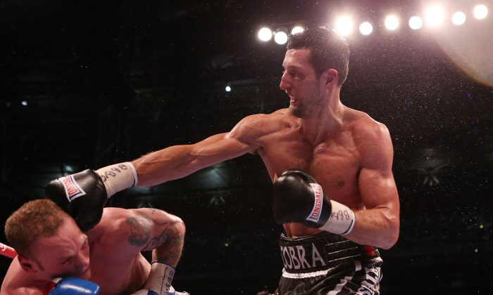 Carl Froch, right, connects with George Groves, during their IBF and WBA World Super Middleweight Title fight at Wembley Stadium in London, Saturday May 31, 2014. (AP Photo / Peter Byrne, PA) UNITED KINGDOM OUT - NO SALES - NO ARCHIVES