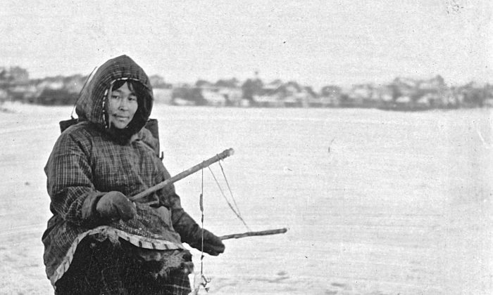 """This archival photo shows an Eskimo woman ice fishing in Nome, Alaska. The long-held assumption that the so-called """"Eskimo diet"""" of high levels of marine animals helps reduce heart disease has been debunked by Canadian researchers. (US Library of Congress)"""