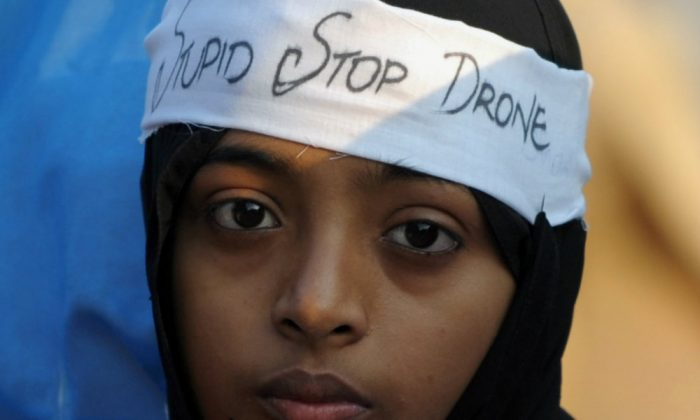 An activist of Pakistan Jamaat-e-Islami party takes part of a protest rally in Karachi on November 24, 2013, against US drone strikes. (Rizwan Tabassum/AFP/Getty Images)