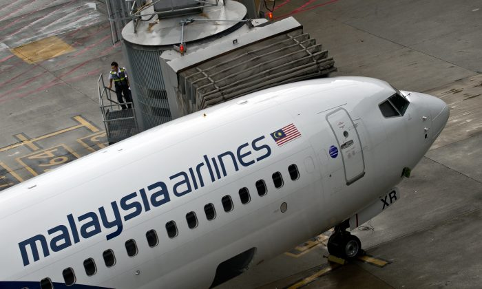 Malaysia Airlines staff board a flight prior to departure at the Kuala Lumpur International Airport in Sepang, May 14, 2014. (Manan Vatsyayana/AFP/Getty Images)