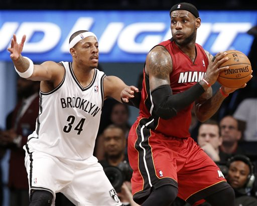 Brooklyn Nets forward Paul Pierce (34) defends Miami Heat forward LeBron James in the first half of Game 4 of their second-round NBA playoff basketball game at the Barclays Center, Monday, May 12, 2014, in New York. (AP Photo/)