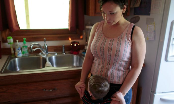 Mindi's daughter was taken by authorities after Mindi had a mental health crisis. Mindi has never been able to get her daughter back, even though she's now capably raising a son. (Steve Herbert for ProPublica)