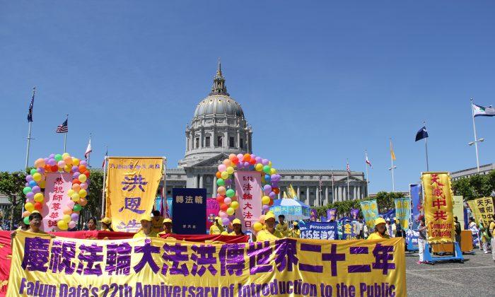 San Francisco Falun Dafa practitioners assemble at the Civic Center to celebrate World Falun Dafa Day, May 10, 2014. (Steve Ispas/Epoch Times)