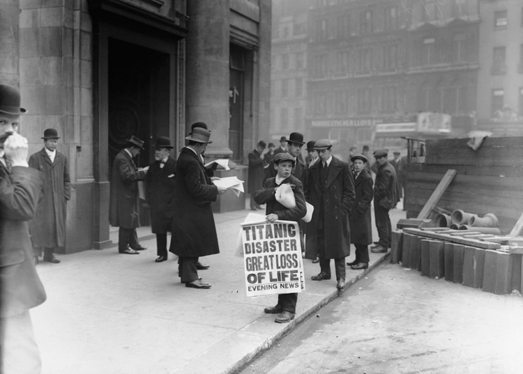 The Titanic sank on April 15, 1912. On April 16, Outside the White Star Line offices in London, newspaper boy Ned Parfett sells copies of the evening paper bearing news of the disaster. Six years later at age 22, Parfett was killed during a German bombardment whilst serving in France, just days before the end of WWI.
