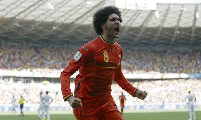 Belgium's Marouane Fellaini celebrates after scoring his side's first goal during the group H World Cup soccer match between Belgium and Algeria at the Mineirao Stadium in Belo Horizonte, Brazil, Tuesday, June 17, 2014.  (AP Photo/Hassan Ammar)