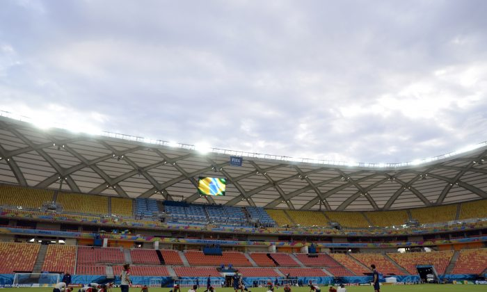 United States' players stretch during a training session at the Arena da Amazonia in Manaus, Brazil, Sunday, June 22, 2014. The U.S. will play Portugal in group G of the 2014 soccer World Cup on June 22. (AP Photo/Paulo Duarte)
