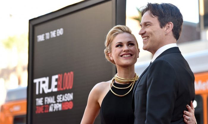 """Anna Paquin, left, and Stephen Moyer arrive at the Los Angeles premiere of the 7th and final season of """"True Blood"""" at the TCL Chinese Theatre on Tuesday, June 17, 2014. (Photo by John Shearer/Invision/AP)"""