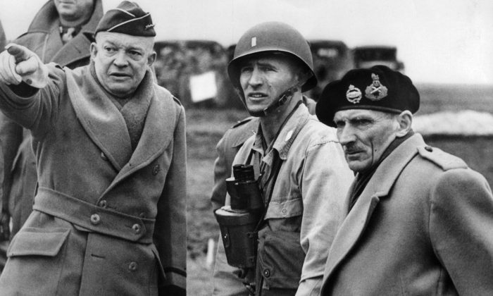 Supreme Commander of the Allied Forces, General Dwight D. Eisenhower (L) shows the strain of his command as he and Britain's Field Marshal Bernard Montgomery (R), his deputy commander, confer on the invasion plans of Normandy in an unknown location in June 1944 after Allied forces stormed the Normandy beaches on D-Day. D-Day, 06 June 1944 is still one of the world's most gut-wrenching and consequential battles, as the Allied landing in Normandy led to the liberation of France which marked the turning point in the Western theater of World War II. (AFP/Getty Images)