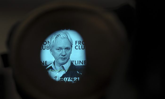 WikiLeaks founder Julian Assange is picture through a camera viewfinder as he speaks at a press conference in central London on Feb. 27, 2012. (Carl Court/AFP/Getty Images)