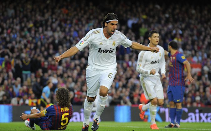 Sami Khedira of Real Madrid CF celebrates after scoring the opening goal during the La Liga match between FC Barcelona and Real Madrid at Camp Nou on April 21, 2012 in Barcelona, Spain. (Photo by David Ramos/Getty Images)