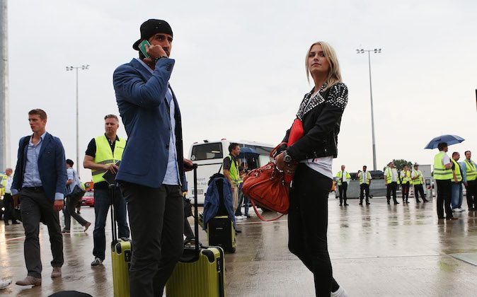 Sami Khedira (L) and and his girlfriend Lena Gercke of Germany arrive at Frankfurt Airport following Germany's defeat to Italy in the semi-final of the UEFA EURO 2012 in Poland on June 29, 2012 in Frankfurt am Main, Germany. (Joern Pollex/Bongarts/Getty Images)