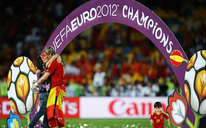 Fernando Torres of Spain kisses his wife Olalla Dominguez on the pitch following victory in the UEFA EURO 2012 final match between Spain and Italy at the Olympic Stadium on July 1, 2012 in Kiev, Ukraine. (Laurence Griffiths/Getty Images)