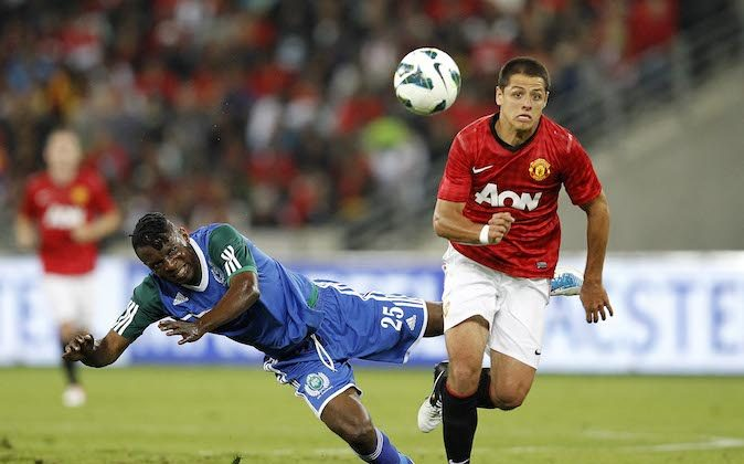 Belux Kasonga of Amazulu and Javier Hernandez of Manchester United battle for the ball during the MTN Football Invitational match between Amazulu and Manchester United, at Moses Mabhida Stadium on July 18, 2012 in Durban, South Africa (Photo by Peter Heeger/Gallo Images/Getty Images)