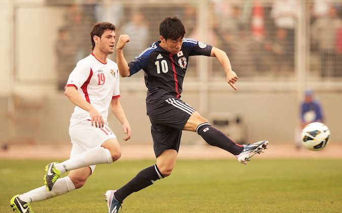 Shinji Kagawa of Japan scores Japans only goal during the FIFA World Cup Asian qualifier match between Jordan and Japan at King Abdullah International Stadium on March 26, 2013 in Amman, Jordan. (Photo by Adam Pretty/Getty Images)